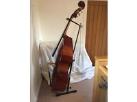 3/4 size Double Bass, with stand for instrument, bow, soft case, and music stand.