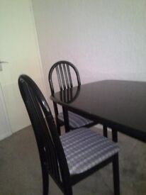 Dining Table and Chairs. Used 6 Place Dining Table in black with 6 Chairs in black