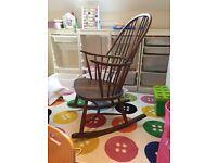 Elegant Ercol Walnut Rocking Chair