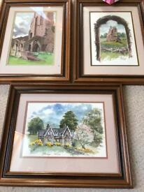 Three wooden framed hand painted pictures of local area