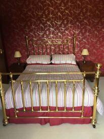 Brass bed surround.