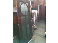 Exterior art deco style hardwood door with frosted glass