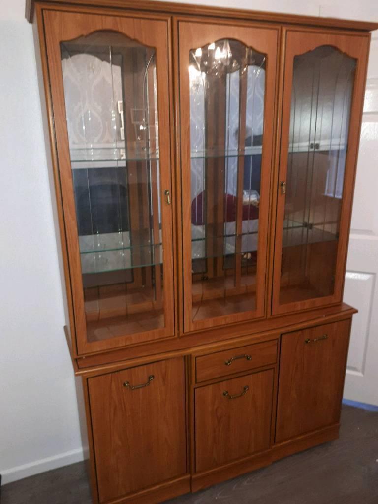 Stunning wooden cabinet with glass door