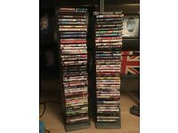 87 DVD movies and 2 DVD stands.