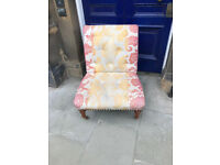 Upholstered Button Back Chair on castor wheels , in good condition. Free Local Delivery
