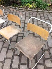 Four metal chairs