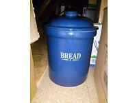 Ceramic bread bin with lid.