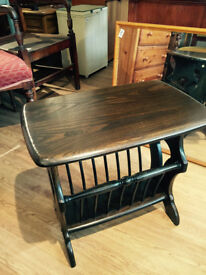 ERCOL magazine rack/ side table , in good condition . Size W 21 in D 14 in H 20 in