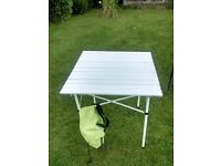 Folding table and kitchen