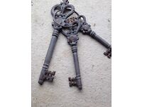THREE LARGE GARDEN ORNAMENTAL KEYS