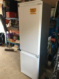 Whirlpool integrated fridgefreezer - virtually new. Installed by house developer