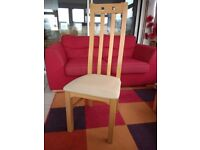Four modern dining chairs with high backs. Solid build.