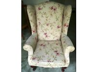 A pair of wing-backed arm chairs for sale in excellent condition.