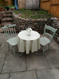 Light Green Metal Bistro Table and Two Wooden Chairs