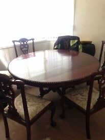 Mahogany dining table with 6 carved chairs