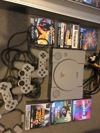 PlayStation with games and remote