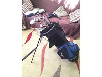 Golf bag with clubs and accesories