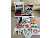 Wii red mini + 7 games inc mario kart + mario bros & wii fit board