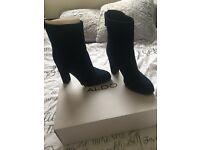 Dark blue high heeled boots