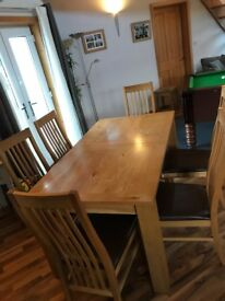 Dining room table and six matching high back chairs. Table also extends. REDUCED FOR QUICK SALE !!!!
