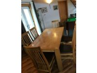 Dining room table and six matching high back chairs. Table also extends if required