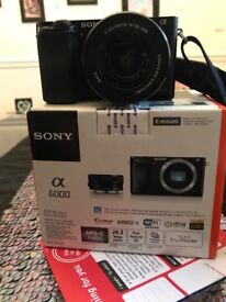 Sony a6000 with lens kit. Like new in box