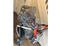 Used Cosatto Pram, with rain cover, car seat, pram and pushchair fittings. good condition