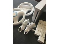 Wii / 2 controllers / 2 Nunchucks / 2 Wheels / Montion Plus / Bunch of games