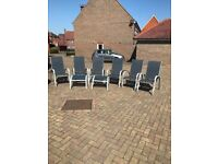 Set of 6 blue mesh construction chairs and 2 footstools.