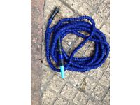 X-hose, a garden hose that extends up to 75 ft.