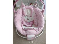 Baby bouncer with vibrating and music option