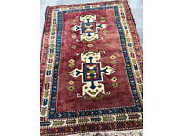 Handmade Rug , mostly reds in colours Size L 78in x W 55in.