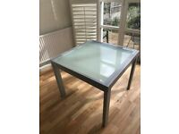 Steel and glass extendable table