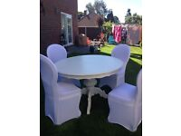 round white shabby chic wooden table and four chairs