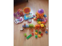 Infant/kids 7 toys.Fisher price cookie shape,fisher-price catapilar,train lego duplo,laptops etc...