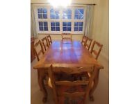 Large Oak table and 8 matching upholstered chairs with engraved backs