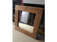 Mirror with wooden frame.
