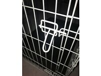 Large two door folding dog crate.