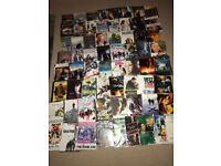 Over 60 mixed copy DVDs