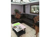 Large brown leather corner sofa.