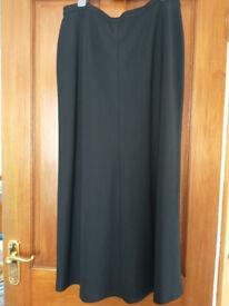 Ladies long, black, smart skirt. Suit taller woman. Waist 32, hip 42/44inches.