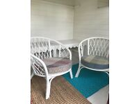 white bamboo chairs with homemade cushions