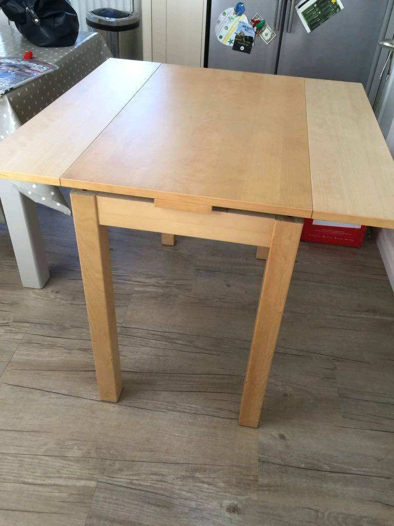 Ikea extendable table with a chair