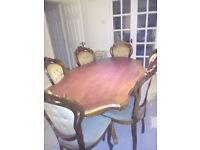 oval dining table inlaid top. plus 6 chairs in gold fabric
