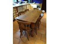 Large pine kitchen table with 6 matching beech chairs