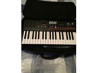 Akai Miniak Synthesizer and Vocoder, with Case