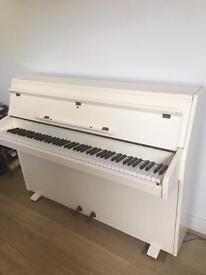 White modern gloss piano