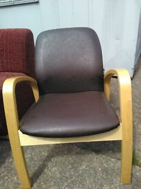 Wooden armed chair with brown faux leather seat. Very good condition and very comfortable