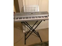 Acoustic solutions electric keyboard with adjustable stand