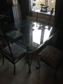 Glass top iron legs dining table 4 chairs